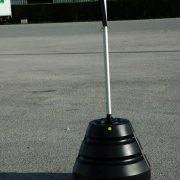 Conical water tank pole holder with banner
